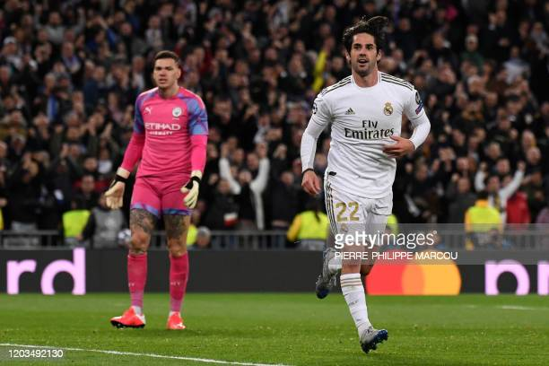 Real Madrid's Spanish midfielder Isco celebrates his goal during the UEFA Champions League round of 16 first-leg football match between Real Madrid...