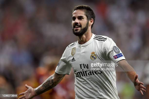 Real Madrid's Spanish midfielder Isco celebrates his team's opening goal during the UEFA Champions League group G football match between Real Madrid...