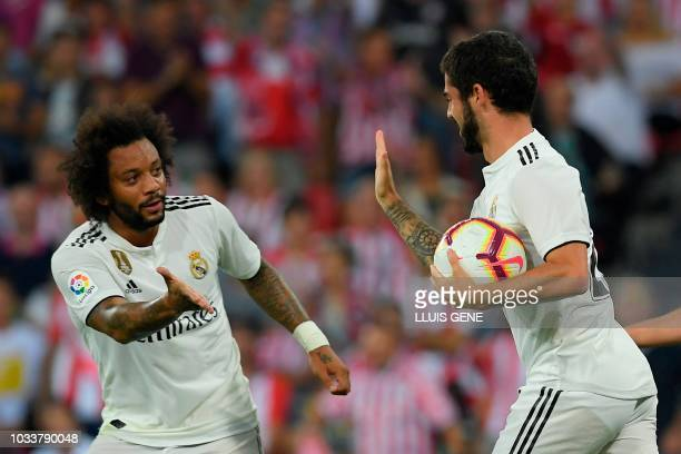 Real Madrid's Spanish midfielder Isco celebrates with Real Madrid's Brazilian defender Marcelo after scoring during the Spanish league football match...