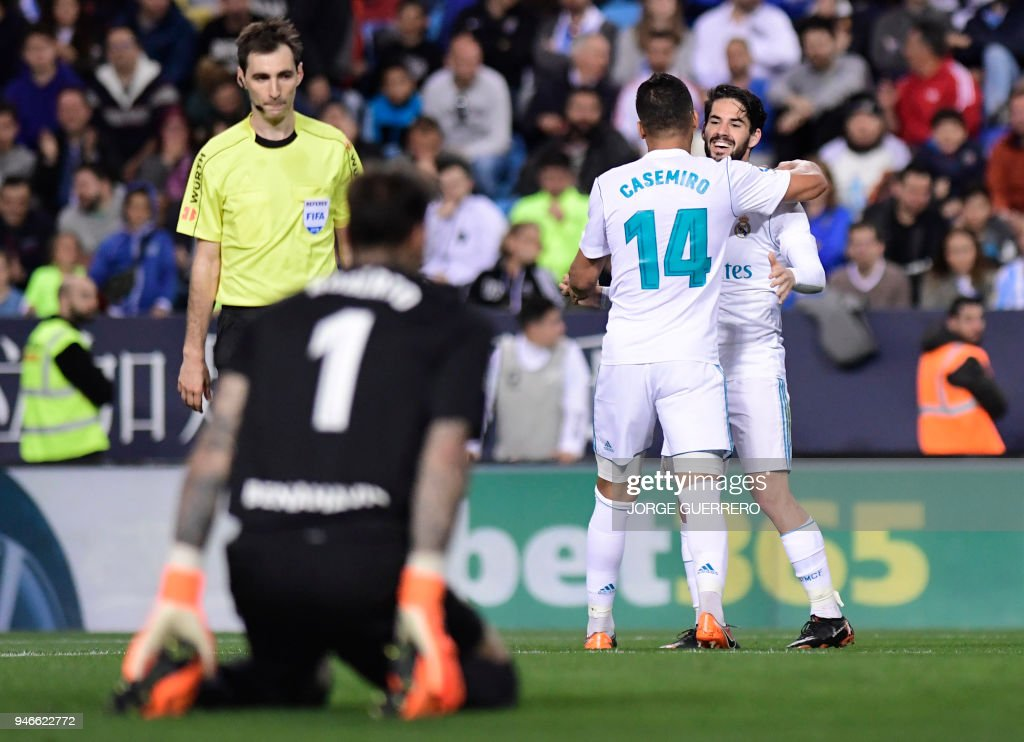 Real Madrid's Spanish midfielder Isco (R) congratulates Real Madrid's Brazilian midfielder Casemiro for his goal during the Spanish league footbal match between Malaga CF and Real Madrid CF at La Rosaleda stadium in Malaga on April 15, 2018. /