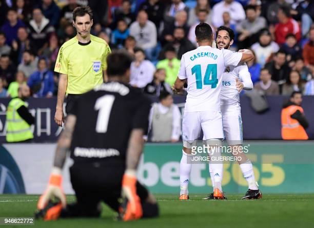 Real Madrid's Spanish midfielder Isco congratulates Real Madrid's Brazilian midfielder Casemiro for his goal during the Spanish league footbal match...