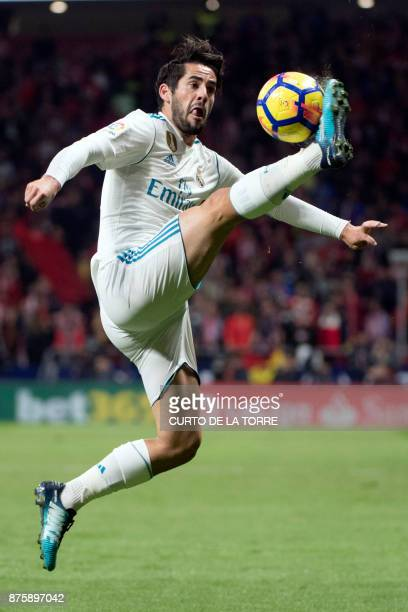 Real Madrid's Spanish midfielder Isco controls the ball during the Spanish league football match Atletico Madrid vs Real Madrid at the Wanda...