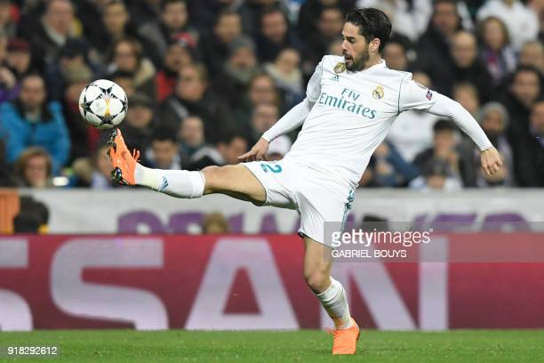 TOPSHOT Real Madrid's Spanish midfielder Isco controls the ball during the UEFA Champions League round of sixteen first leg football match Real...