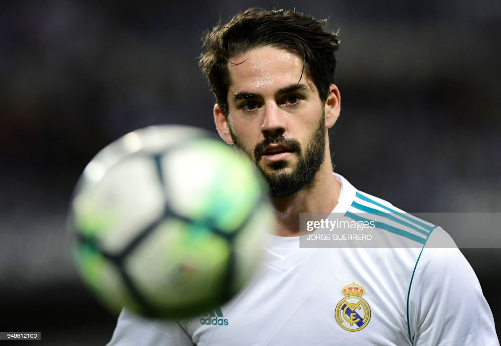 Real Madrid's Spanish midfielder Isco eyes the ball during the Spanish league footbal match between Malaga CF and Real Madrid CF at La Rosaleda stadium in Malaga on April 15, 2018. /