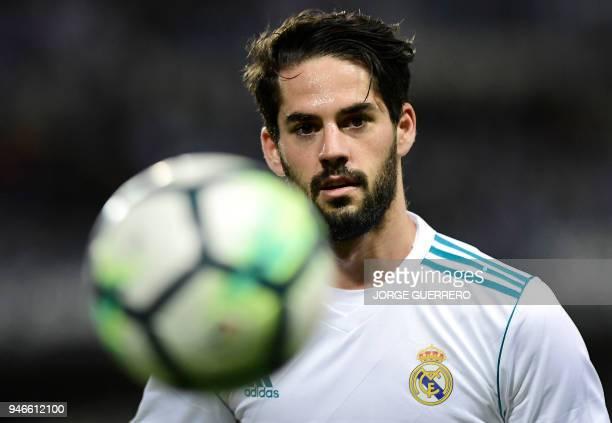 Real Madrid's Spanish midfielder Isco eyes the ball during the Spanish league footbal match between Malaga CF and Real Madrid CF at La Rosaleda...
