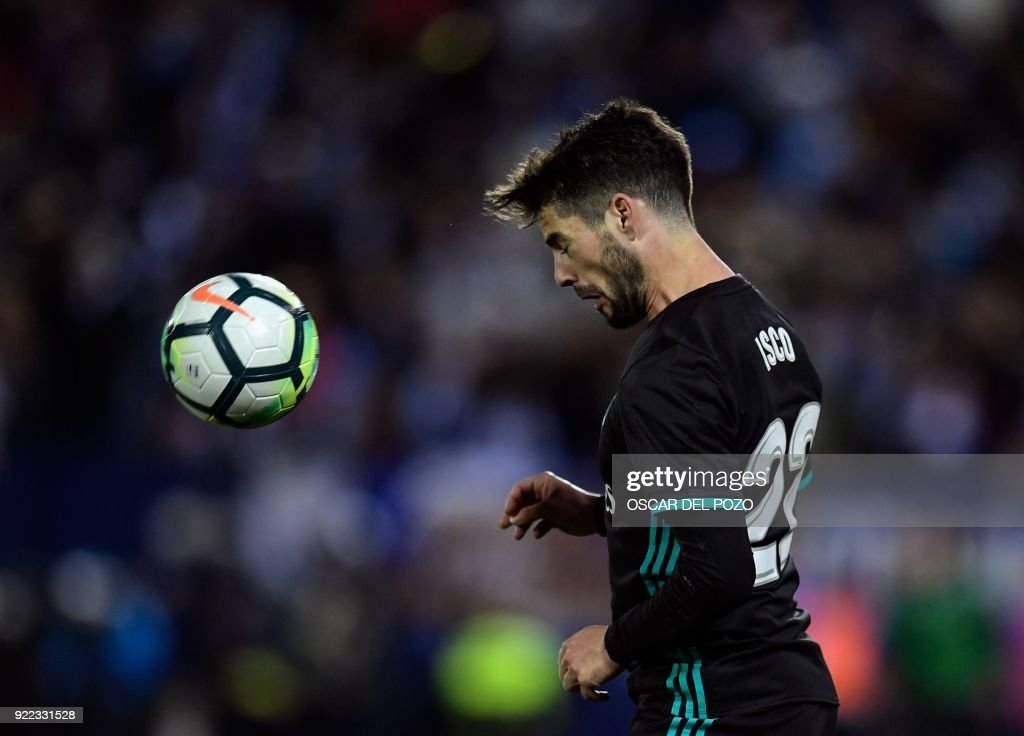 Real Madrid's Spanish midfielder Isco heads the ball during the Spanish league football match Club Deportivo Leganes SAD against Real Madrid CF at the Estadio Municipal Butarque in Leganes on the outskirts of Madrid on February 21, 2018. /