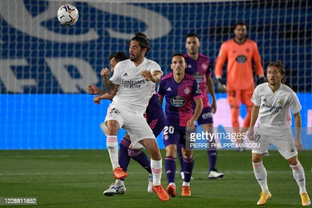 Real Madrid's Spanish midfielder Isco jumps for the ball during the Spanish league football match Real Madrid CF against Real Valladolid FC at the...