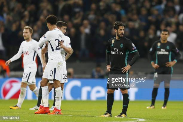 Real Madrid's Spanish midfielder Isco reacts after Tottenham scored their third goal during the UEFA Champions League Group H football match between...