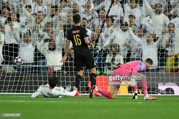 Real Madrid's Spanish midfielder Isco scores a goal past Manchester City's Brazilian goalkeeper Ederson and Manchester City's Spanish midfielder...