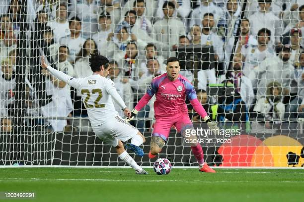Real Madrid's Spanish midfielder Isco scores a goal past Manchester City's Brazilian goalkeeper Ederson during the UEFA Champions League round of 16...