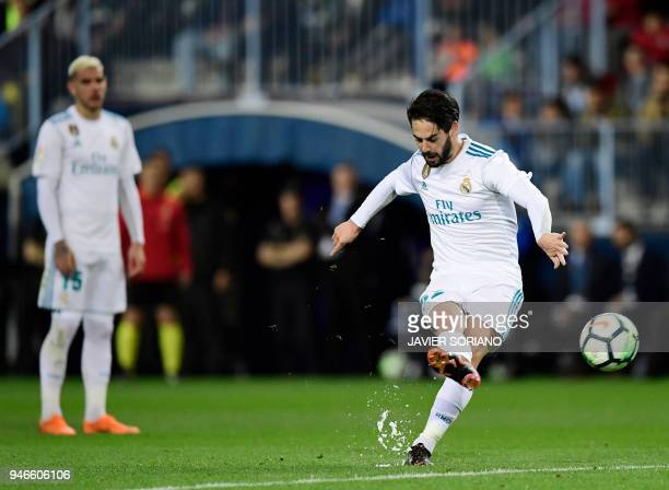 Real Madrid's Spanish midfielder Isco shoots a free kick to score a goal during the Spanish league footbal match between Malaga CF and Real Madrid CF...