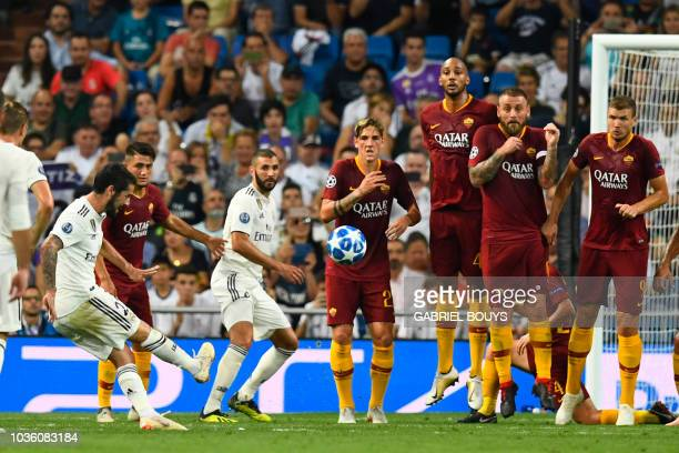 Real Madrid's Spanish midfielder Isco shoots to score the opening goal during the UEFA Champions League group G football match between Real Madrid CF...