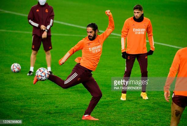 Real Madrid's Spanish midfielder Isco takes part in the training session on the eve of the UEFA Champions League group B football match Borussia...
