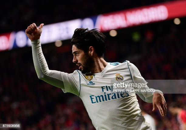 Real Madrid's Spanish midfielder Isco thumbs up during the Spanish league football match Atletico Madrid vs Real Madrid at the Wanda Metropolitan...