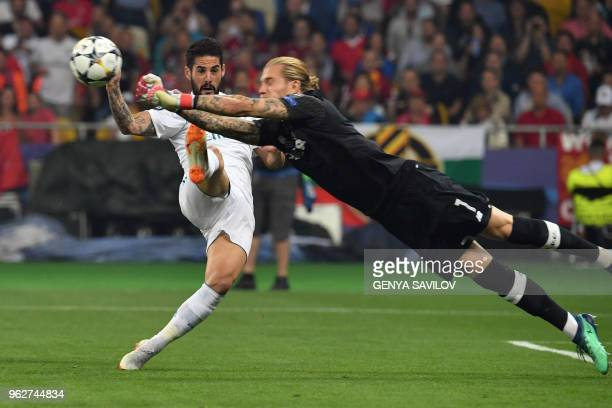 Real Madrid's Spanish midfielder Isco vies for the ball with Real Madrid's Spanish defender Dani Carvajal during the UEFA Champions League final...