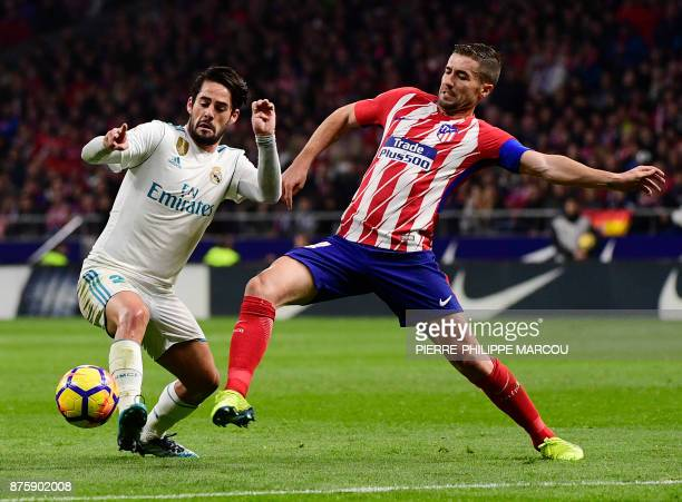 Real Madrid's Spanish midfielder Isco vies with Atletico Madrid's Spanish midfielder Gabi during the Spanish league football match Atletico Madrid vs...
