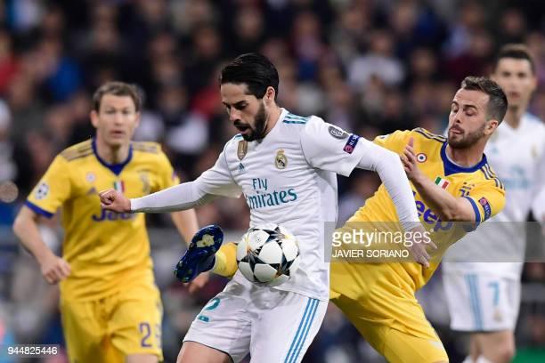 Real Madrid's Spanish midfielder Isco vies with Juventus' Italian midfielder Miralem Pjanic during the UEFA Champions League quarterfinal second leg...