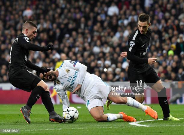 Real Madrid's Spanish midfielder Isco vies with Paris SaintGermain's Italian midfielder Marco Verratti during the UEFA Champions League round of...