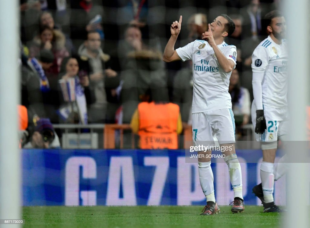 Real Madrid's Spanish midfielder Lucas Vazquez (L) celebrates a goal during the UEFA Champions League group H football match Real Madrid CF vs Borussia Dortmund at the Santiago Bernabeu stadium in Madrid on December 6, 2017. /
