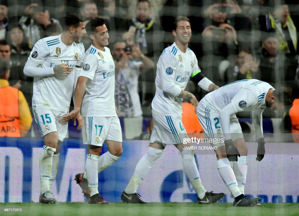 Real Madrid's Spanish midfielder Lucas Vazquez (L) celebrates a goal with teammates during the UEFA Champions League group H football match Real Madrid CF vs Borussia Dortmund at the Santiago Bernabeu stadium in Madrid on December 6, 2017. /