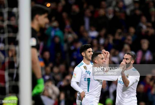 Real Madrid's Spanish midfielder Lucas Vazquez celebrates a goal with teammates during the Spanish League football match between Real Madrid CF and...