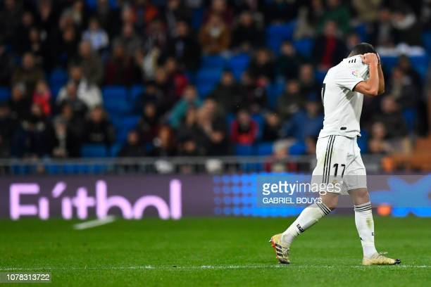 Real Madrid's Spanish midfielder Lucas Vazquez leaves the field after been handed a red card during the Spanish League football match between Real...
