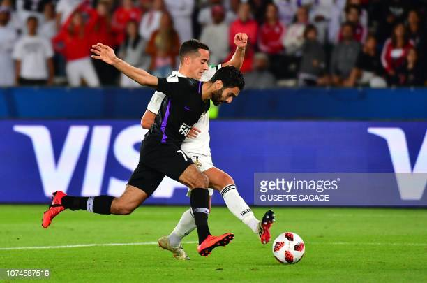 Real Madrid's Spanish midfielder Lucas Vazquez vies for the ball with AlAin's midfielder Hussein elShahat during the Final match in the FIFA Club...
