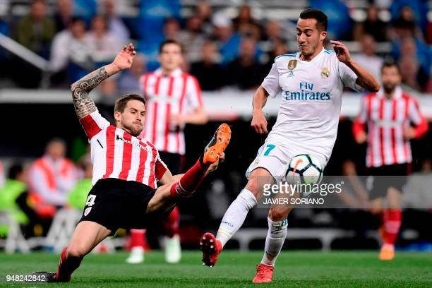 Real Madrid's Spanish midfielder Lucas Vazquez vies with Athletic Bilbao's Spanish defender Inigo Martinez during the Spanish league football match...