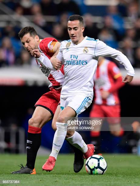 Real Madrid's Spanish midfielder Lucas Vazquez vies with Girona's Spanish midfielder Alex Granell during the Spanish League football match between...
