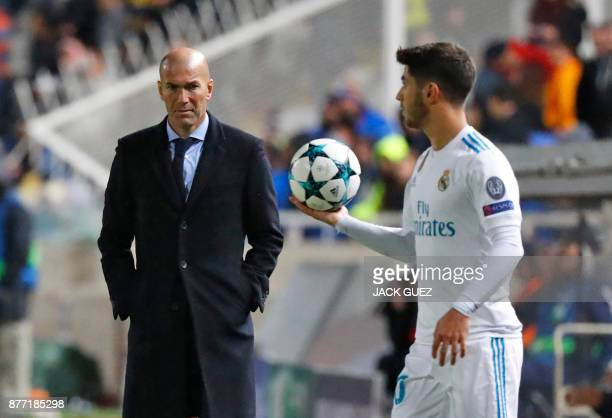 Real Madrid's Spanish midfielder Marco Asensio and Real Madrid's French head coach Zinedine Zidane are seen the UEFA Champions League Group H match...