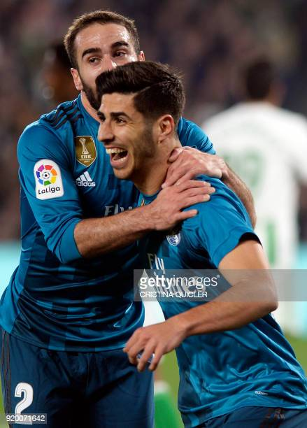 Real Madrid's Spanish midfielder Marco Asensio celebrates a goal with Real Madrid's Spanish defender Dani Carvajal during the Spanish Liga football...
