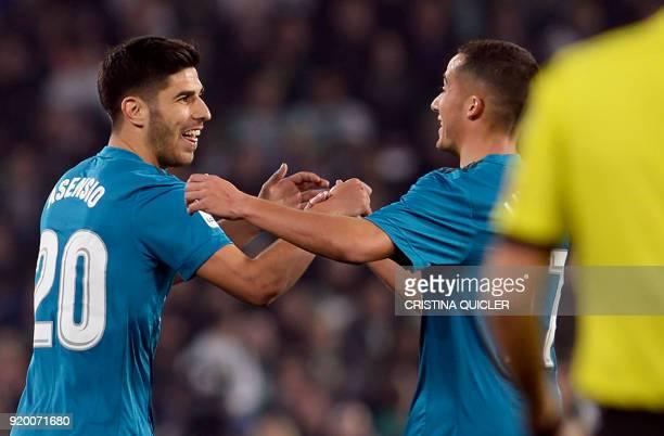 Real Madrid's Spanish midfielder Marco Asensio celebrates a goal with Real Madrid's Spanish midfielder Lucas Vazquez during the Spanish Liga football...