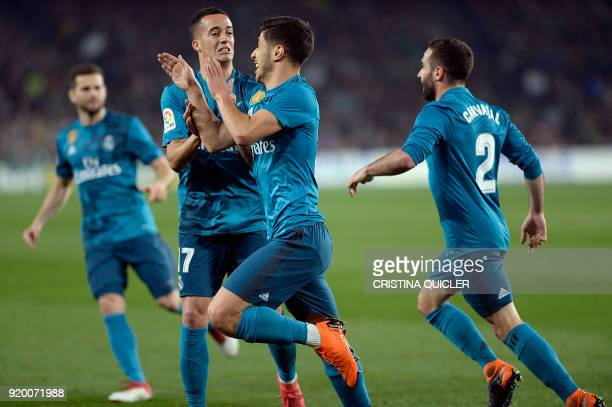 Real Madrid's Spanish midfielder Marco Asensio celebrates a goal with teammates during the Spanish Liga football match Real Betis vs Real Madrid at...