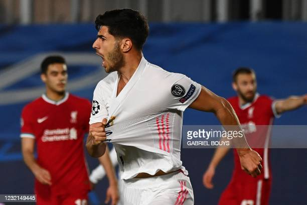 Real Madrid's Spanish midfielder Marco Asensio celebrates after scoring a goal during the UEFA Champions League first leg quarter-final football...