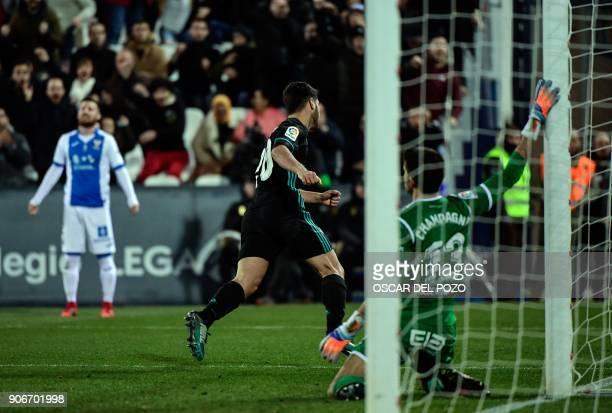 Real Madrid's Spanish midfielder Marco Asensio celebrates after scoring a goal during the Spanish 'Copa del Rey' football match between Leganes and...