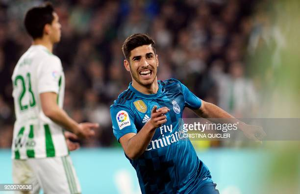 Real Madrid's Spanish midfielder Marco Asensio celebrates after scoring a goal during the Spanish league football match Real Betis vs Real Madrid at...