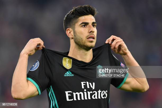 Real Madrid's Spanish midfielder Marco Asensio celebrates after scoring a goal during the UEFA Champions League semi-final first-leg football match...