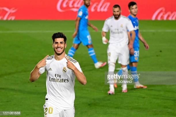 Real Madrid's Spanish midfielder Marco Asensio celebrates his goal during the Spanish league football match between Real Madrid CF and Valencia CF at...