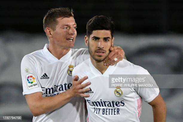 Real Madrid's Spanish midfielder Marco Asensio celebrates his goal with Real Madrid's German midfielder Toni Kroos during the Spanish League football...