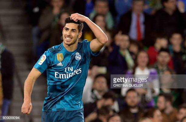 Real Madrid's Spanish midfielder Marco Asensio celebrates scoring a goal during the Spanish league football match Real Betis vs Real Madrid at the...