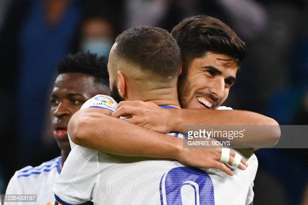 Real Madrid's Spanish midfielder Marco Asensio celebrates scoring his team's fourth goal with Real Madrid's French forward Karim Benzema during the...