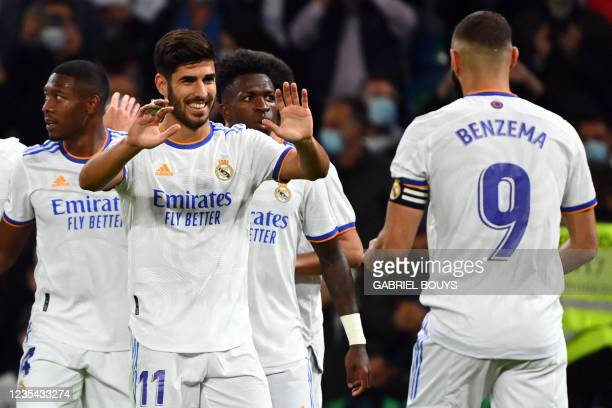 Real Madrid's Spanish midfielder Marco Asensio celebrates scoring his team's fourth goal during the Spanish League footbal match between Real Madrid...