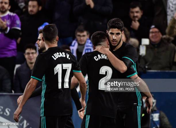 Real Madrid's Spanish midfielder Marco Asensio celebrates with teammates after scoring a goal during the Spanish 'Copa del Rey' football match...