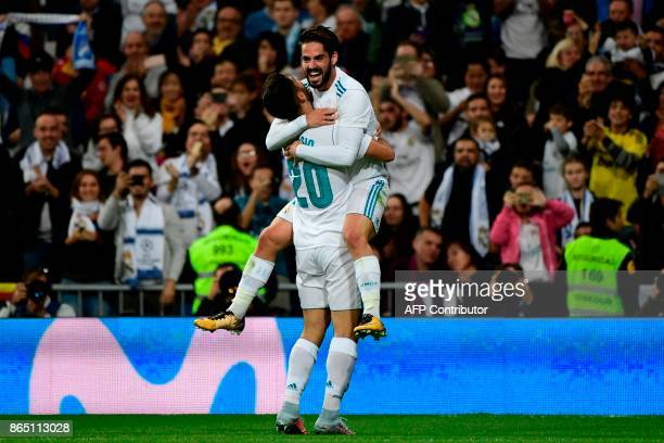 Real Madrid's Spanish midfielder Marco Asensio celebrates with Real Madrid's Spanish midfielder Isco after scoring a goal during the Spanish league...