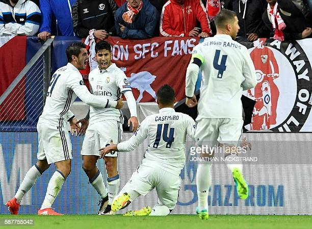 Real Madrid's Spanish midfielder Marco Asensio celebrates with team mates during the UEFA Super Cup final football match between Real Madrid CF and...