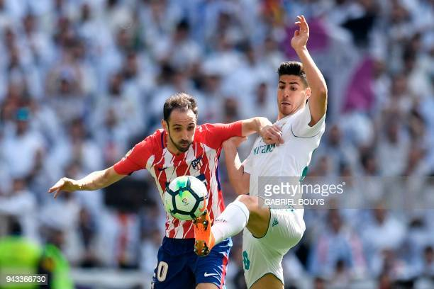 Real Madrid's Spanish midfielder Marco Asensio challenges Atletico Madrid's Spanish defender Juanfran during the Spanish league football match...
