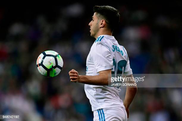 Real Madrid's Spanish midfielder Marco Asensio controls the ball during the Spanish league football match Real Madrid CF against Athletic Club Bilbao...