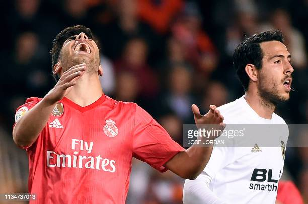 Real Madrid's Spanish midfielder Marco Asensio gestures during the Spanish league football match between Valencia CF and Real Madrid CF at the...