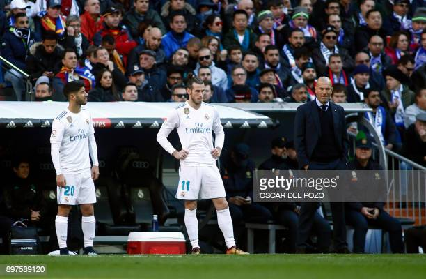 Real Madrid's Spanish midfielder Marco Asensio Real Madrid's Welsh forward Gareth Bale and Real Madrid's French coach Zinedine Zidane look on during...