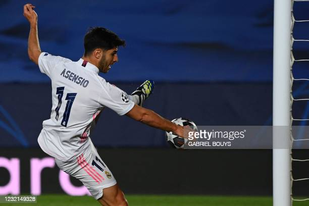 Real Madrid's Spanish midfielder Marco Asensio scores a goal during the UEFA Champions League first leg quarter-final football match between Real...